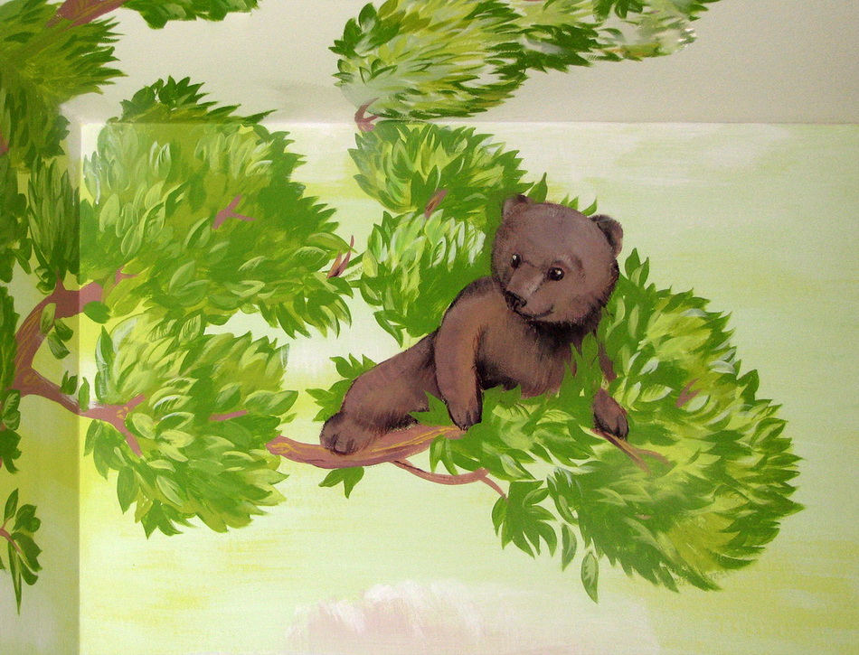 A fragment of the mural with a little bear on the tree