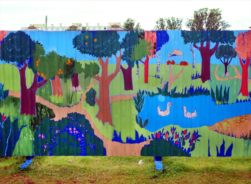 «The Forest» Mural on a metal fence covering a construction zone.