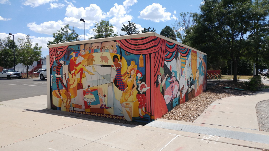 Yulia_Avgustinovich_Denver_Muralist Aurora Fox Mural Theater_Decoration_Colorado_public_Art